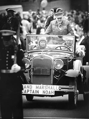 Philadelphia area kids' TV star Captain Noah rides through the Wilmington Christmas Parade in an antique Ford as grand marshal. 1987.
