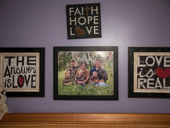 A family photo of the Riners hangs in Jessica Riner's