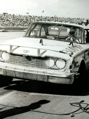 Curtis Turner pits during the first World 600. A window