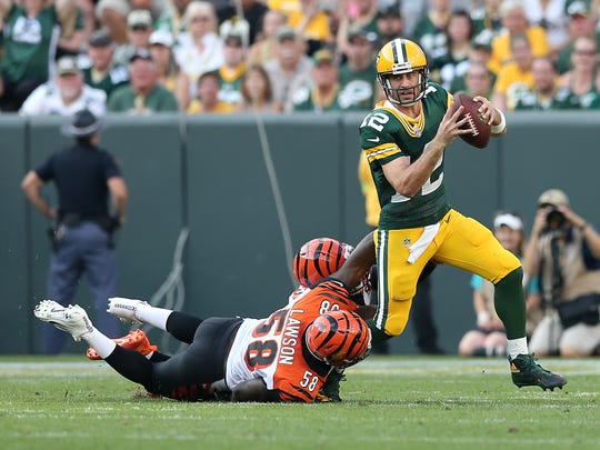 Green Bay Packers quarterback Aaron Rodgers (12) is pressured by Cincinnati Bengals linebacker Carl Lawson (58) in the third quarter during the Week 3 NFL football game between the Cincinnati Bengals and the Green Bay Packers, Sunday, Sept. 24, 2017, at Lambeau Field in Green Bay, Wisconsin.