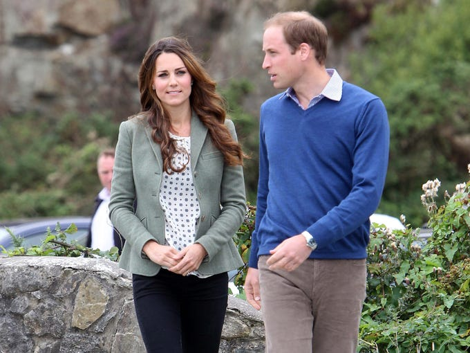 Prince William and Duchess Kate arrive for the start of the Ring O' Fire Anglesey Coastal Ultra-Marathon in Wales on Aug. 30. It's her first public appearance since the birth of Prince George on July 22.  He's the official starter for the 135-mile race, and she joined him at the last minute to say goodbye to Wales before moving back to London.