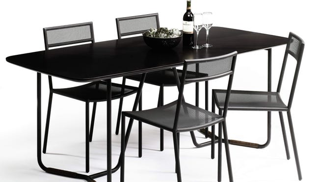 Sauder Boutique's Boot Leg dining table pairs a charcoal-black finish with leather-wrapped legs.