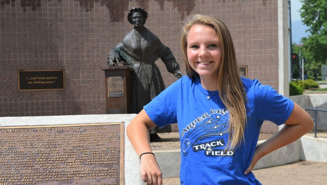 Harper Creek's Megan Kusler has been named 2018 Battle Creek Enquirer Female Athlete of the Year. She stands in front of the Sojourner Truth statue, which welcomes visitors to Battle Creek.