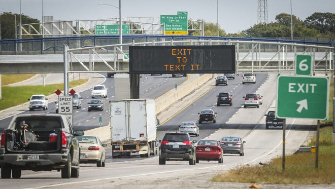 """An Iowa Department of Transportation's """"Message Monday"""" discourages texting while driving along I-235 in Des Moines on Monday, Oct. 5, 2015."""