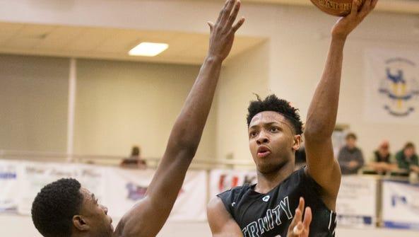 Trinity Shamrocks guard David Johnson (13) shoots the