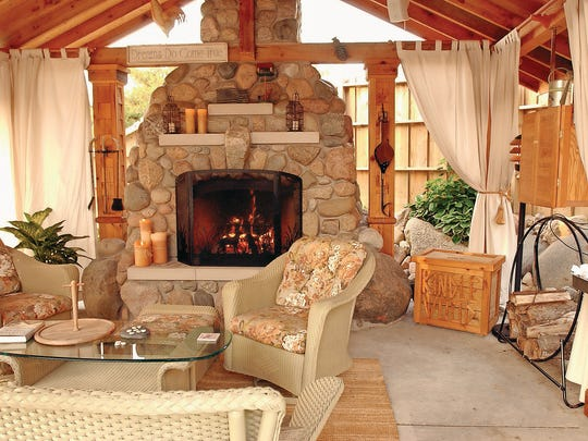 A wood-burnng fireplace is a centerpiece in this backyard