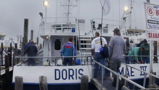 Fishermen board the Doris Mae IV in Barnegat Light before a bottom fishing trip.