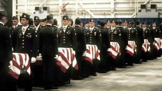 Soldiers from 2nd Brigade Combat Team, 101st Airborne Division carry the remains of the 248 soldiers who perished in the crash of Arrow Air Flight 1285 near Gander International Airport in Newfoundland, Canada, Dec. 12, 1985.