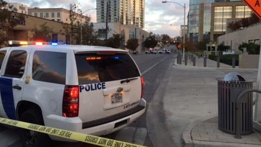 Police block off an area in front of the U.S. federal courthouse in Austin after a gunman opened fire on several downtown buildings on Nov. 28, 2014.