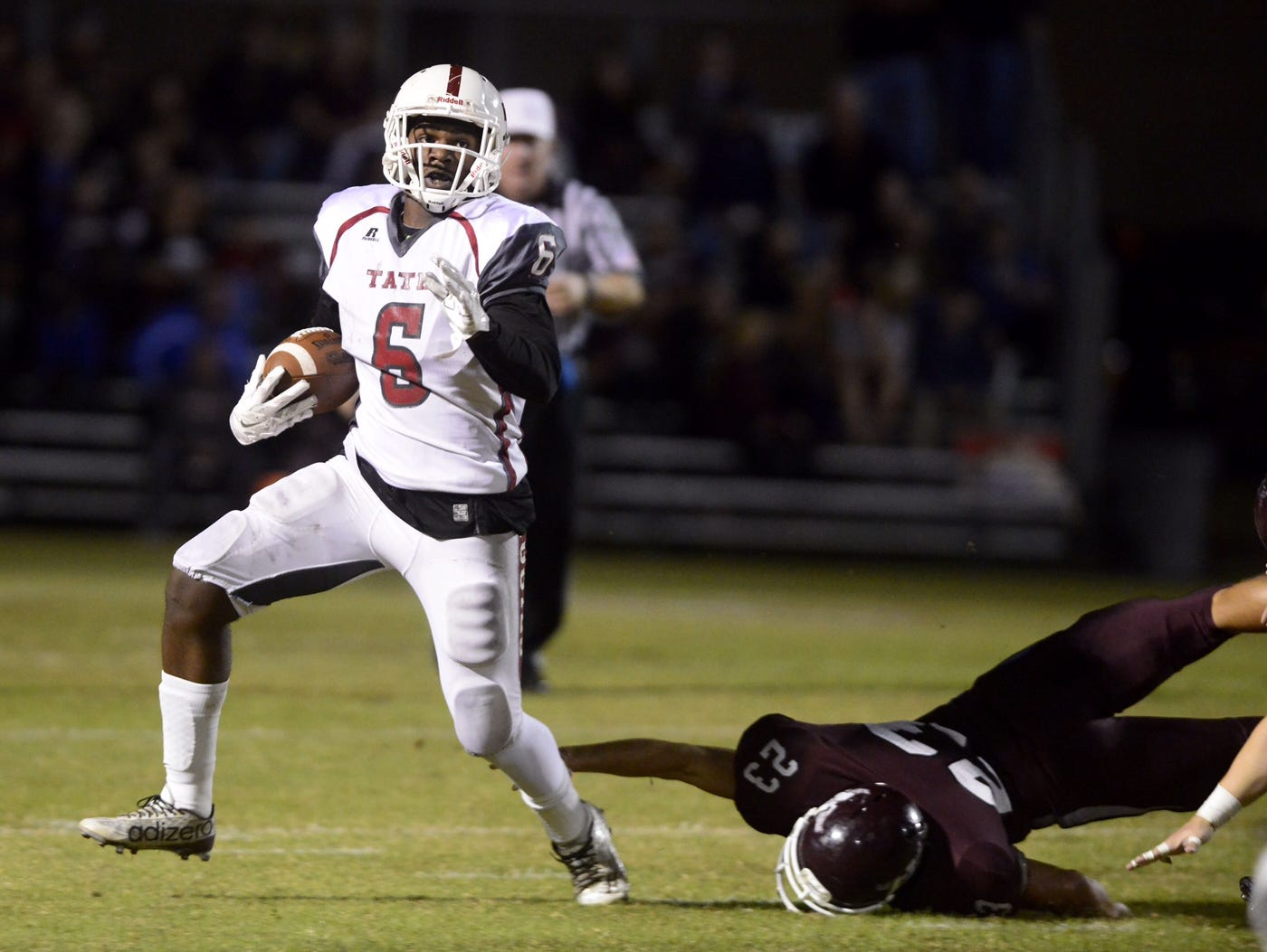 Tate High School's Dee Thompson avoids a tackle from Niceville's Scott Armfield Friday as the Aggies hold on to beat the Eagles 21-20. Tate advances to the Class 6A State Semifinals vs. Seffner Armwood.