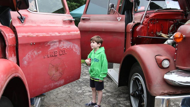 John Loeffler, 6, takes a look inside a 1955 GMC fire truck during the 26th Annual Antique Truck Show and Toy & Collectible Flea Market in Florham Park on Sunday.
