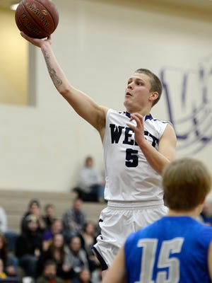 Green Bay West's Clayton Trepanier (5) takes a shot past Green Bay Southwest's Lucas Steffes (15) in the second quarter during Tuesday night's basketball game at Green Bay West High School. Evan Siegle/Press-Gazette Media
