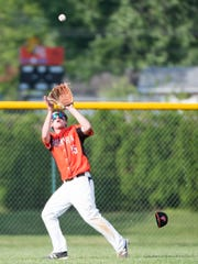 Palmyra's Evan Hallowell makes a catch during the Cougars' eighth win in a row this spring, a first-round district tournament victory over West York.