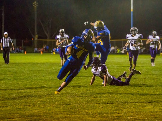 Parowan running back Trey Jense (4) carries the ball for a touchdown during Friday's game against Wayne, September 29, 2017.