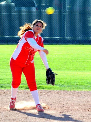 Loving's Candace Martinez makes a throw to first against Eunice on Thursday. Martinez and the Lady Falcons won 10-0.