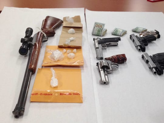 Authorities confiscated guns, methamphetamine and cash during a sweep in Coachella and other local communities Wednesday morning.