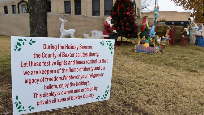 Moments after a nativity scene was erected at the Baxter County Courthouse on Thursday morning, a sign was posted detailing the quorum court's public disclaimer on the religious display.