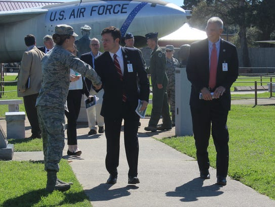 U.S. Rep. Mike Johnson shakes hands with 1st Lt. Jessica