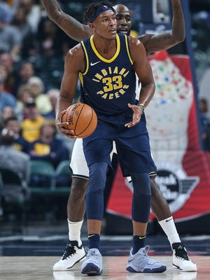 Indiana Pacers forward Myles Turner (33) looks for an open teammate during first half action between the Indiana Pacers and Brooklyn Nets in the home opener at Banker's Life Fieldhouse, Indianapolis, Wednesday, Oct. 18, 2017.