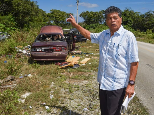 Yigo Mayor Rudy Matanane expresses his objection on abandoned vehicles found along Chalan Bada in Yigo on Thursday, March 16, 2017. Matanane is hoping to use the identification numbers, he collected from the vehicles illegally dumped at the site, to track down the owners. The mayor says he will not tolerate the disposal of automobiles and the increasing amount of trash that have been improperly discarded of in his village.