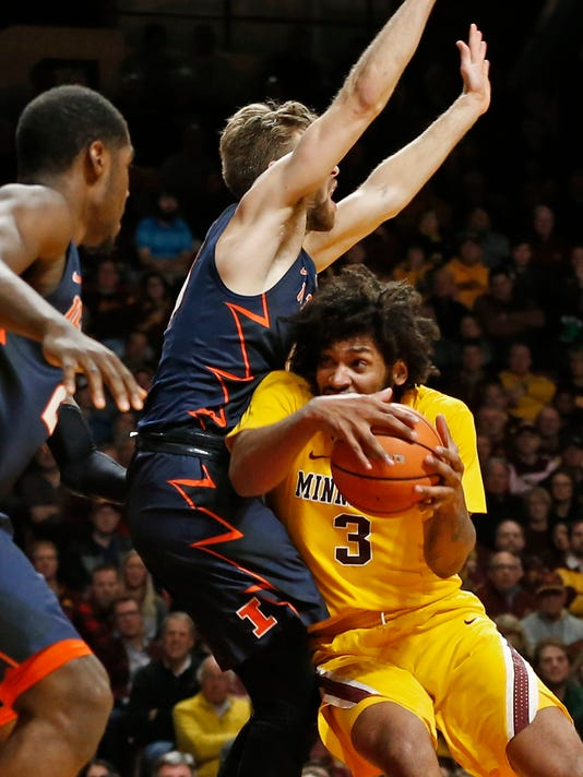Minnesota's Jordan Murphy, right, drives into Illinois' Mark Smith during the second half of an NCAA college basketball game Wednesday, Jan. 3, 2018, in Minneapolis. Murphy scored 16 points in Minnesota's 77-67 win. (AP Photo/Jim Mone)