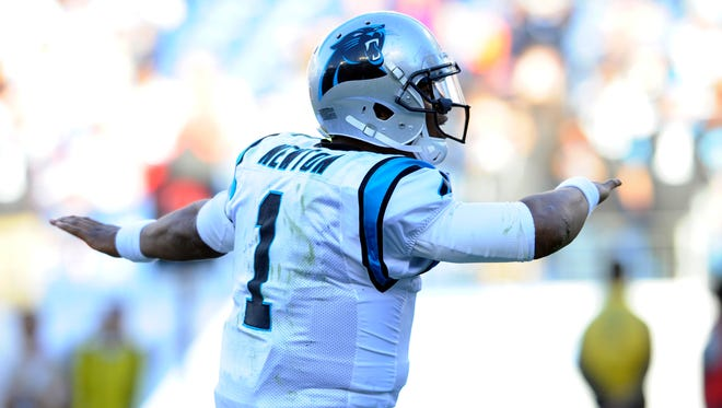 Carolina Panthers quarterback Cam Newton (1) celebrates after a touchdown during the second half against the Tennessee Titans at Nissan Stadium. The Panthers won 27-10.