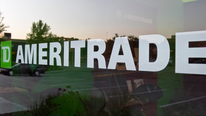 In this 2010 file photo, a TD Ameritrade logo is displayed on the office in Omaha, Neb.