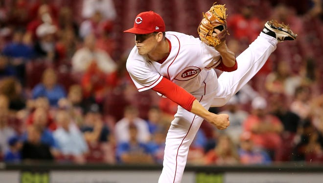 Cincinnati Reds relief pitcher Kevin Shackelford (41) delivers in the eighth inning during the game between the New York Mets and the Cincinnati Reds on Tuesday, Aug. 29 at Great American Ball Park.