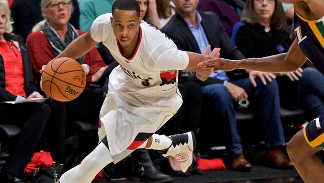 Portland Trail Blazers guard C.J. McCollum, left, dribbles past Utah Jazz guard Rodney Hood, right, during the first half of an NBA basketball game in Portland, Ore., Tuesday, Oct. 25, 2016. (AP Photo/Craig Mitchelldyer)