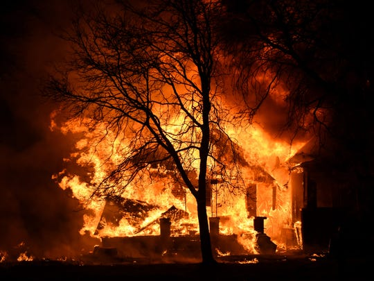 Detroit Firefighters took a defensive stance at an abandon dwelling fire on Kirby St. between Elmwood and McDougall St. on Detroit's near east side just after midnight in this file photo from Devil's Night Oct. 31, 2014.
