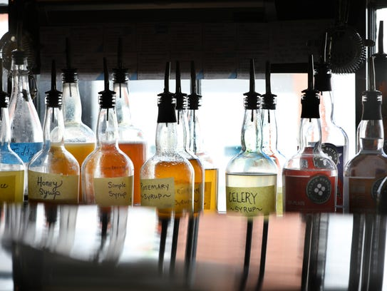 Syrups behind the bar at Black Button Distilling.
