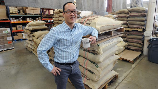 Colectivo's vice president of coffee, Al Liu, at the company's Humboldt Boulevard cafe and roasting operation. Liu has traveled the world researching coffee varieties and steeping himself in coffee knowledge.