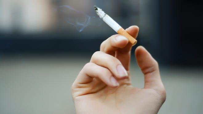 FILE -- person smoking a cigarette