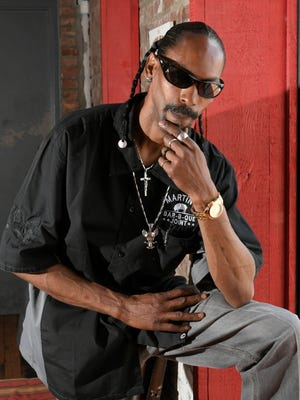 Snoop Dogg look-alike Leonard Bell works at the downtown Martin's Bar-B-Que, just four blocks from the Ascend Amphitheater where the real Snoop will play April 28.