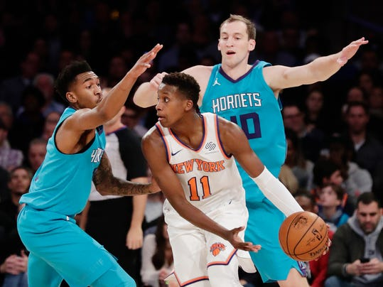 New York Knicks' Frank Ntilikina (11) is defended by Charlotte Hornets' Cody Zeller, right, and Malik Monk during the first half of an NBA basketball game Tuesday, Nov. 7, 2017, in New York. (AP Photo/Frank Franklin II)