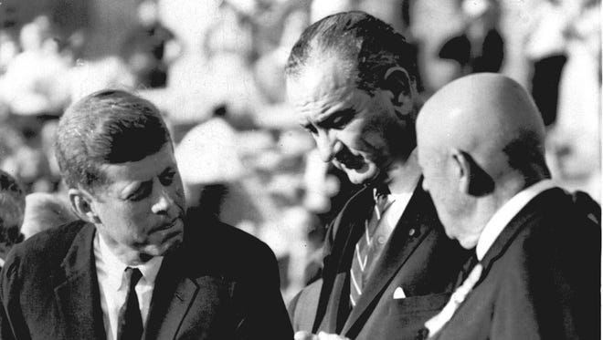 U.S. Sens. John F. Kennedy, left, and Lyndon B. Johnson speak to Speaker Sam Rayburn in the Los Angeles Coliseum where they accepted the Democratic party's nomination July 15,1960.