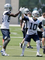In this photo taken June 13, 2017, Dallas Cowboys receiver Ryan Switzer (10) gets a high five from fellow wide receiver Dez Bryant during an NFL football practice at the team's training facility in Frisco, Texas. (AP Photo/Jaime Dunaway)