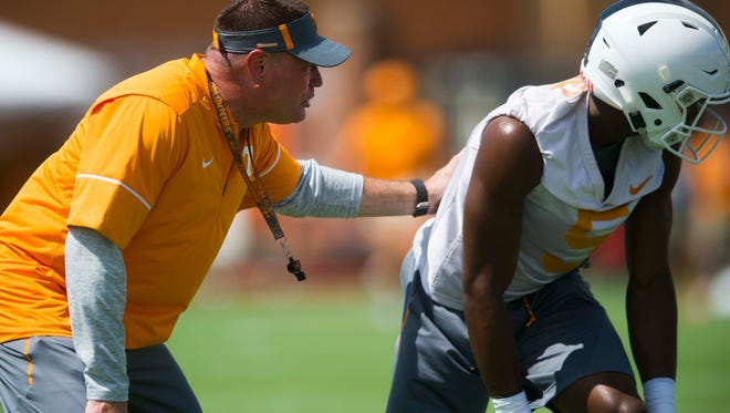Head Coach Butch Jones coaches wide receiver Josh Palmer at the first University of Tennessee fall football practice of the year at Anderson Training Facility in Knoxville, Tenn. on Saturday, July 29, 2017.