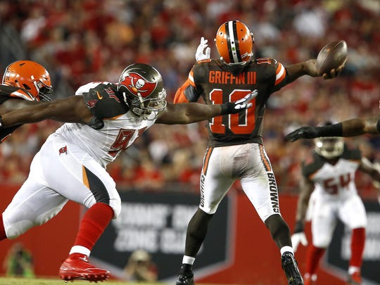 Aug 26, 2016; Tampa, FL, USA; Tampa Bay Buccaneers defensive tackle Akeem Spence (97) and defensive end William Gholston (92) put the pressure on Cleveland Browns quarterback Robert Griffin III (10) during the second quarter of a football game at Raymond James Stadium. Mandatory Credit: Reinhold Matay-USA TODAY Sports