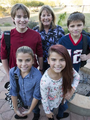 Kathy Britton with her sons Jett (left) 16, and Jonah (right), 11, and twin daughters Ana (left) and Tea, 13, at their Gilbert home November 17, 2015. Kathy enrolled Jett at Pieceful Solutions and her other kids at San Tan Charter School, both in Gilbert.