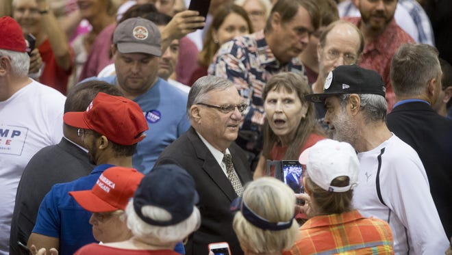 Then-Sheriff Joe Arpaio mingles with a crowd during a rally for Donald Trump at the Phoenix Convention Center on Oct. 29, 2016.