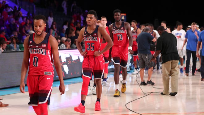Nov 23, 2017;  Paradise Island, BAHAMAS; Arizona Wildcats guard Parker Jackson-Cartwright (0) and guard Allonzo Trier (35) and forward Deandre Ayton (13) react after the loss to the SMU Mustangs in the 2017 Battle 4 Atlantis in Imperial Arena at the Atlantis Resort. Mandatory Credit: Kevin Jairaj-USA TODAY Sports