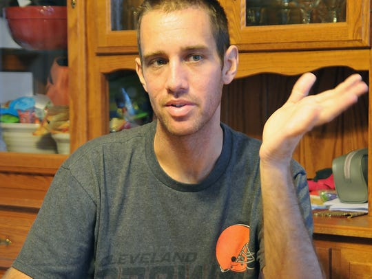 Eric Stitzlien talks about his disease at his home.