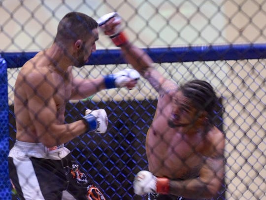 Saipan's Shane Alvarez defeats USA's Emilio Urrutia with a rear naked choke in the bantamweight division of PXC54 at the University of Guam Calvo Field House, July 8.