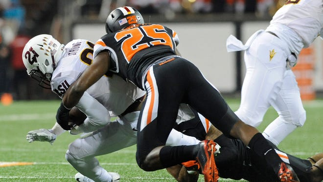 Oregon State safety Ryan Murphy tackles Arizona State receiver Jaelen Strong at Reser Stadium on Nov. 15, 2014. The Beavers beat the No. 6-ranked Sun Devils 35-27.