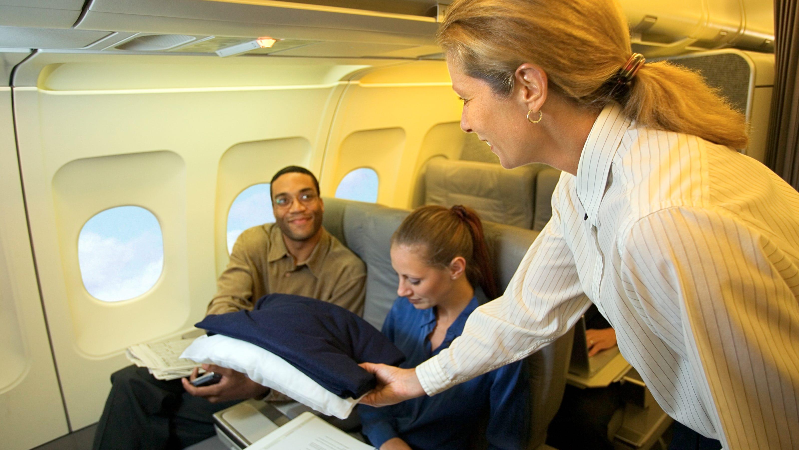 Image result for flight attendant giving free