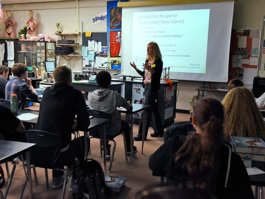 Lori Braegelmann, outreach coordinator for the Epilepsy Foundation of Minnesota, talks to a health careers class about seizures Wednesday, Oct. 28 at Apollo High School.
