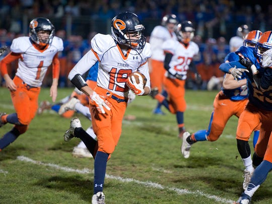 Galion's Caleb Ivy runs the ball in the first quarter.