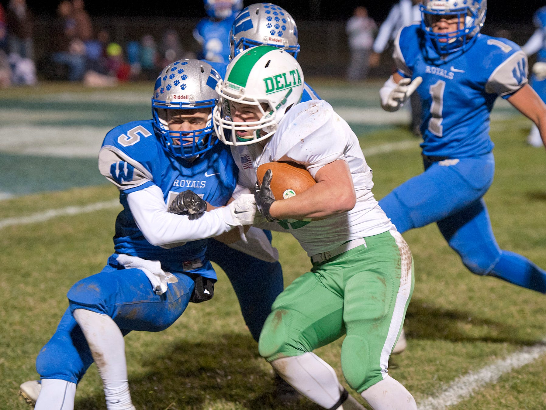 Wynford's Cole Fortner pushes against the Delta offense.