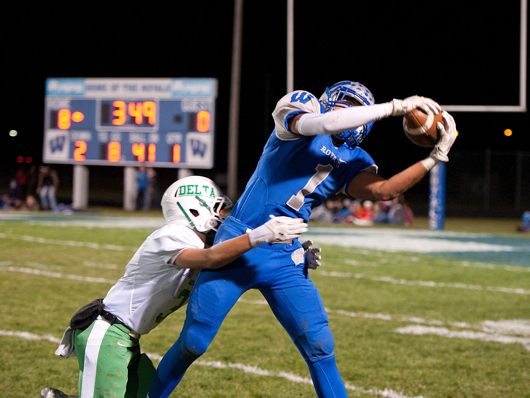 Wynford's Tony Watson catches a pass in the first quarter.